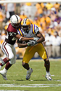 Baton Rouge, LA - SEPTEMBER 30:  Early Doucet #9 of the LSU Tigers runs with the ball against the Mississippi State Bulldogs at Tiger Stadium on September 30, 2006 in Baton Rouge, Louisiana.  The Tigers defeated the Bulldogs 48 - 17.  (Photo by Wesley Hitt/Getty Images) *** Local Caption *** Early Doucet