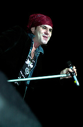"""Quireboys lead singer """"Spike"""" (Jonathan Gray) performing on stage at the  Monsters of Rock Festival. The last night of an eleven date tour at the Hallam FM Arena, Sheffield on Tuesday 26th November<br /> Copyright Paul David Drabble<br /> Freelance Photographer<br /> 07831 853913<br /> 0114 2468406<br /> www.pauldaviddrabble.co.uk<br /> [#Beginning of Shooting Data Section]<br /> Nikon D1 <br /> 2002/11/26 20:13:58.4<br /> JPEG (8-bit) Fine<br /> Image Size:  2000 x 1312<br /> Color<br /> Lens: 80-200mm f/2.8-2.8<br /> Focal Length: 135mm<br /> Exposure Mode: Manual<br /> Metering Mode: Spot<br /> 1/250 sec - f/2.8<br /> Exposure Comp.: 0 EV<br /> Sensitivity: ISO 400<br /> White Balance: Auto<br /> AF Mode: AF-S<br /> Tone Comp: Normal<br /> Flash Sync Mode: Front Curtain<br /> Auto Flash Mode: External<br /> Color Mode: <br /> Hue Adjustment: <br /> Sharpening: Normal<br /> Noise Reduction: <br /> Image Comment: <br /> [#End of Shooting Data Section]"""