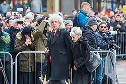 © Licensed to London News Pictures. 31/03/2018. Cambridge, UK. Brian May arrives at the funeral of Stephen Hawking at Church of St Mary the Great in Cambridge, Cambridgeshire. Professor Hawking, who was famous for ground-breaking work on singularities and black hole mechanics, suffered from motor neurone disease from the age of 21. He died at his Cambridge home in the morning of 14 March 2018, at the age of 76. Photo credit: Rob Pinney/LNP