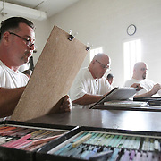 Mark Gentry, far left, works on a portrait of a fellow inmate during an art class at Nash Correctional Institution.