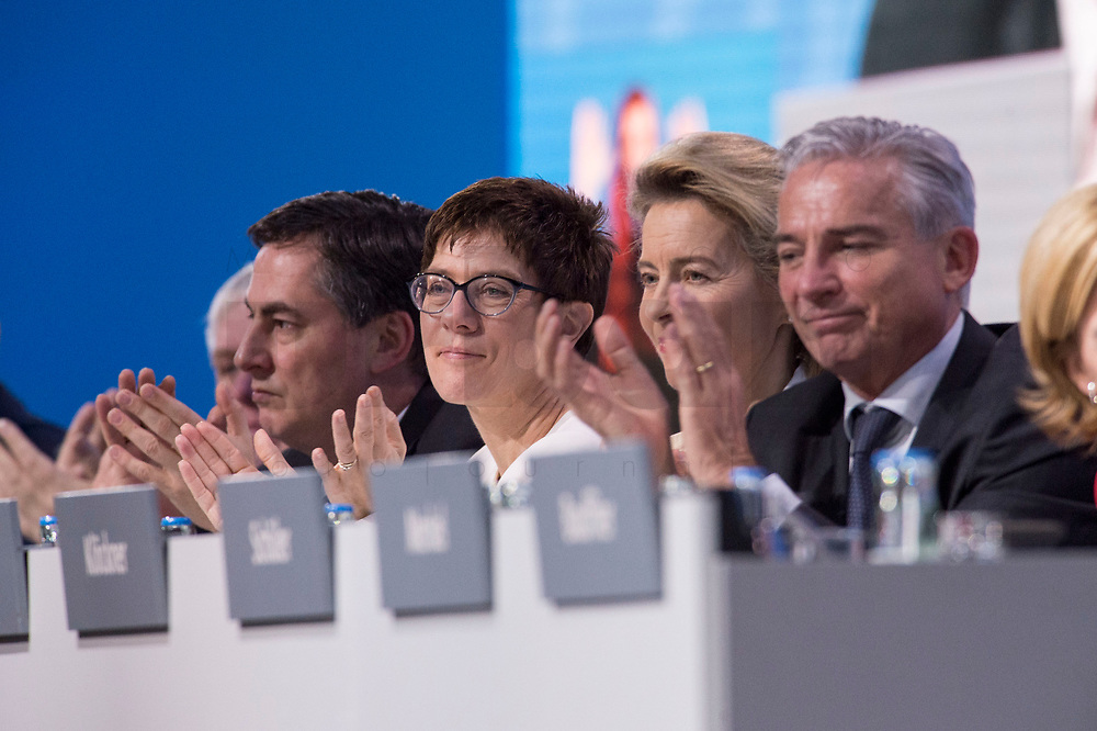26 FEB 2018, BERLIN/GERMANY:<br /> David McAllister, CDU, MdEP, Annegret Kramp-Karrenbauer (M), CDU, desig. Generalsekraetrin, Ursula von der Leyen, CDU, Bundesverteidigungsministerin, und Thomas Strobl, CDU Landesvorsitzender Baden-Wuerttemberg, (v.L.n.R.), waehrend der Rede von Angela Merkel, CDU, Bundeskanzlerin, CDU Bundesparteitag, Station Berlin<br /> IMAGE: 20180226-01-040<br /> KEYWORDS: Party Congress, Parteitag, klatsche, Applaus, Applaudieren