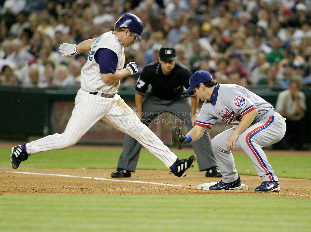 Phoenix, AZ 05-15-04. Arizona Diamondbacks Shea Hillenbrand makes it back to first base on an attempted steal in a game against the Montreal Expos. Montreal won 5-0. Ross Mason photo