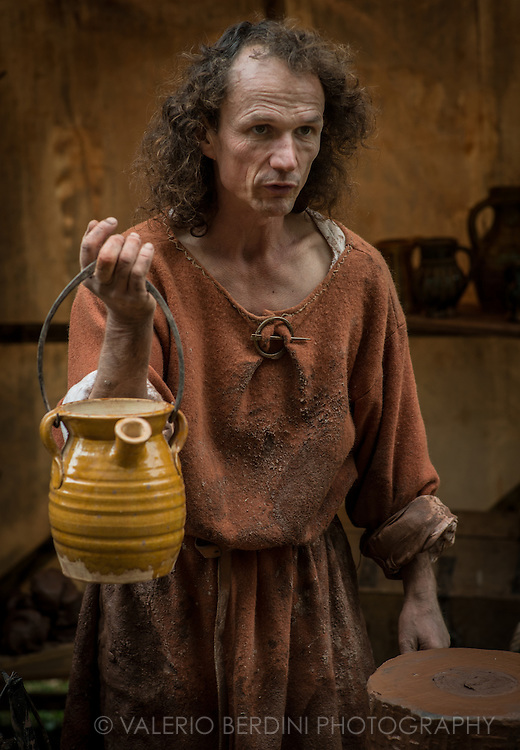 A potter carrying water to make ceramic vases. It's been 950 years since King Harold got an arrow in the eye at the Battle of Hastings. A group of re-enactors set up a camp near Apsley House in Hyde Park, London, to show their weapons, games and living arrangements.