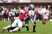 STARKVILLE, MS - NOVEMBER 17:  Ty Storey #4 of the Arkansas Razorbacks fumbles the ball after being hit by Leo Lewis #10 and Chauncey Rivers #5 of the Mississippi State Bulldogs at Davis Wade Stadium on November 17, 2018 in Starkville, Mississippi.  The Bulldogs defeated the Razorbacks 52-6.  (Photo by Wesley Hitt/Getty Images) *** Local Caption *** Ty Storey; Leo Lewis; Chauncey Rivers