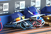 LOS ANGELES, CA - JUNE 17:  Baseball caps, gloves, and sunglasses lie on the dugout bench during batting practice before the Los Angeles Dodgers game against the Colorado Rockies at Dodger Stadium on Tuesday, June 17, 2014 in Los Angeles, California. The Dodgers won the game 4-2. (Photo by Paul Spinelli/MLB Photos via Getty Images)