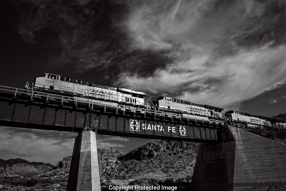 Monochrome photograph of Burlington Northern Santa Fe train as it travels east across northern Arizona