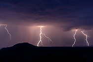 Lightning beyond Otowi Peak and Buckman Mesa into the foothills of the Sangre de Cristo Mountains, viewed from the White Rock Canyon Overlook at Overlook Park, Los Alamos, NM, © 2018 David A. Ponton