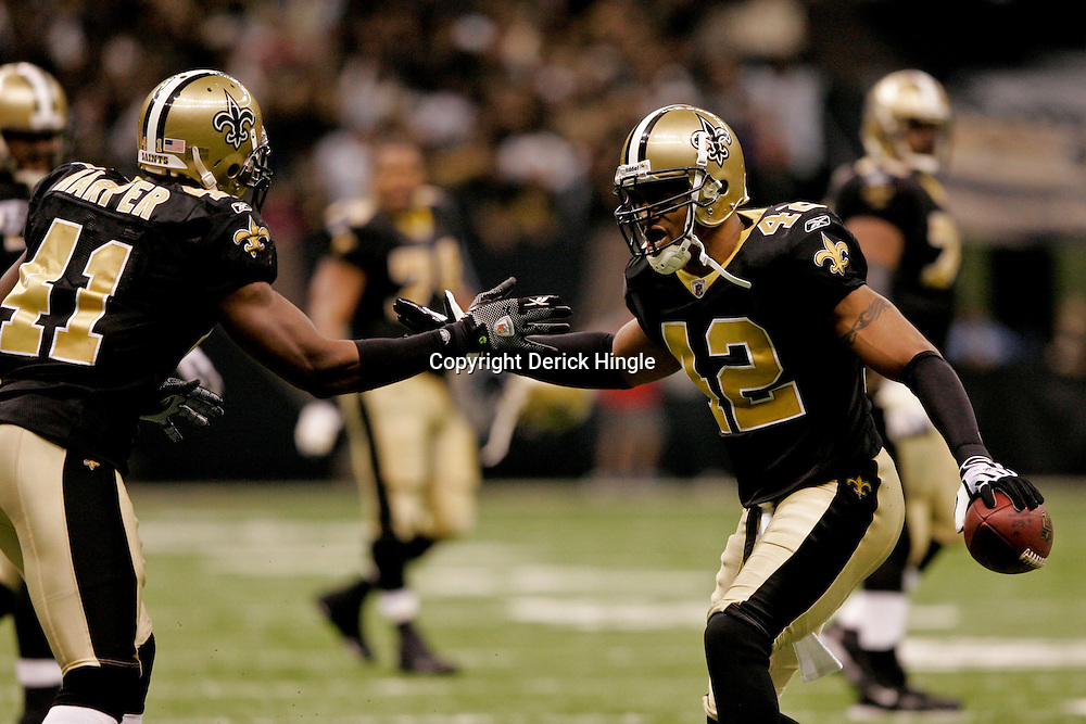 2009 November 30:  New Orleans Saints safety Darren Sharper (42) celebrates with teammate safety Roman Harper (41) after intercepting a pass during a 38-17 win by the New Orleans Saints over the New England Patriots at the Louisiana Superdome in New Orleans, Louisiana.
