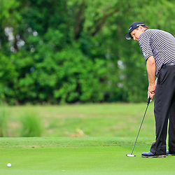 Apr 28, 2016; Avondale, LA, USA; J.J. Henry putts on the 16th hole during the first round of the 2016 Zurich Classic of New Orleans at TPC Louisiana. Mandatory Credit: Derick E. Hingle-USA TODAY Sports