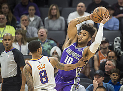 December 29, 2017 - Sacramento, CA, USA - The Sacramento Kings' Frank Mason III (10) looks for an open teammate as he's defended by the Phoenix Suns' Tyler Ulis (8) on Friday, Dec. 29, 2017, at the Golden 1 Center in Sacramento, Calif. (Credit Image: © Hector Amezcua/TNS via ZUMA Wire)