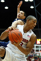 November 10, 2010; Stanford, CA, USA;  Stanford Cardinal forward/center Josh Owens (13) grabs a rebound against the Cal State Monterey Bay Otters during the first half at Maples Pavilion.