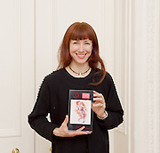 Sylvie Guillem CBE receives The De Valois Award for Outstanding Achievement 2015 from The Chairman of the Critics' Circle National Dance Awards Graham Watts OBE at a ceremony at The Polish Club, London, Great Britain <br /> 1st March 2016 <br /> <br /> <br /> Photograph by Elliott Franks