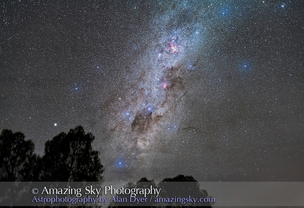 The southern Milky Way in Carina and Crux rising from behind gum trees and with light cloud moving in to haze the stars, Alpha Centauri is just clearing the trees. The Carina Nebula is at top. Omega Centauri is at left. <br /> <br /> This is a stack of 4 x 2-minute exposures at f/2.8 with the 35mm lens and Canon 5D MkII at ISO 3200. One exposure layerd in for the trees. Tracked on the iOptron Sky-Tracker.