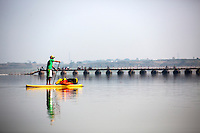 Jay paddles toward a pontoon bridge on Day 1 of our trip to Varanasi.