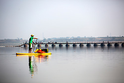 Jay paddles toward a pontoon bridge on Day 1 of our trip to Varanasi.