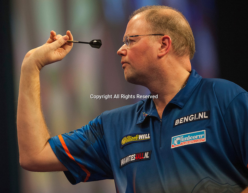 03.01.2015.  London, England.  William Hill PDC World Darts Championship.  Semi Final Round. Raymond van Barneveld (14) [NED] in action during his game with Phil Taylor (2) [ENG]