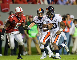 Virginia quarterback Jameel Sewell (10) rushes up field for a first down.  The North Carolina State Wolfpack defeated the #15 Virginia Cavaliers 29-24 at Carter Finley Stadium in Raleigh, NC on October 27, 2007.