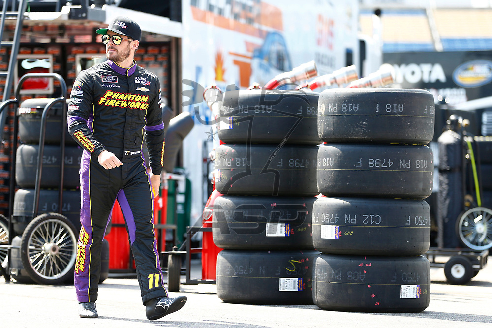 Ryan Truex (11) hangs out in the garage during practice for the Alsco 300 at Kentucky Speedway in Sparta, Kentucky.
