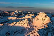Lone Peak in the Madison Range in alpenglow light.