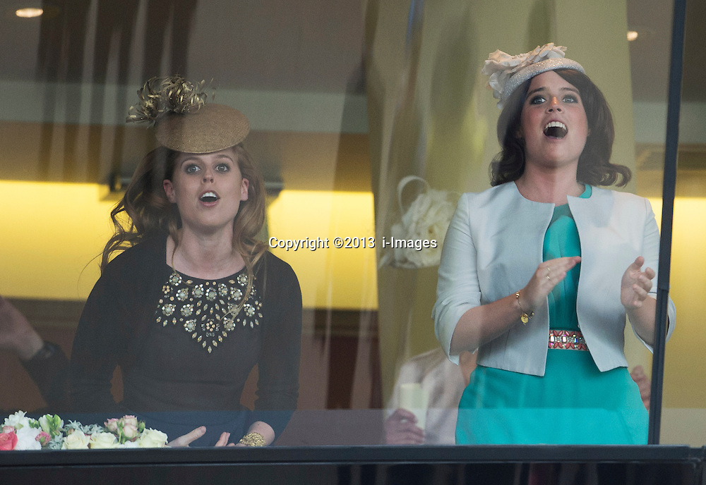 Princess Beatrice and Eugenie watching the horse owned by HM The Queen  Estimate win the Gold Cup at Royal Ascot 2013,<br /> Ascot, United Kingdom,<br /> Thursday, 20th June 2013<br /> Picture by i-Images