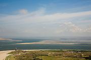 Nederland, Noord-Holland, Texel, 14-07-2008; vuurtoren bij De Cocksdorp, zicht op de Waddenzee tussen Texel en Vlieland, het Robbengat en Vogelzwin; op het tweede plan droogvallende platen  (Steenplaat, Hengst, Ballastplaat); vogel- en natuurreservaat; eb en vloed, getijden, getijdegebied, zand. .luchtfoto (toeslag); aerial photo (additional fee required); .foto Siebe Swart / photo Siebe Swart