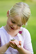 Six year old Elise Sabin checks out a grasshopper near Whitefish Montana model released