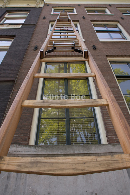 ladder against the outside of a house Amsterdam Holland