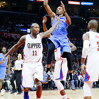 21 December 2015: Oklahoma City Thunder forward Kevin Durant (35) takes a jump shot over Los Angeles Clippers guard Jamal Crawford (11) during the Oklahoma City Thunder 100-99 victory over the Los Angeles Clippers, at the Staples Center, Los Angeles, California, USA.