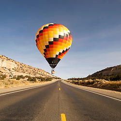 113012       Brian Leddy.A balloon flies over Highway 566 near Churchrock Friday morning during the Red Rock Balloon Rally.