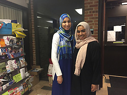 June 20, 2017 - Naperville, IL, USA - Safa Farid and Sana Khadri stand in the Islamic Center of Naperville after breaking their fast with dates and an iftar meal. (Credit Image: © Erin Hegarty/TNS via ZUMA Wire)