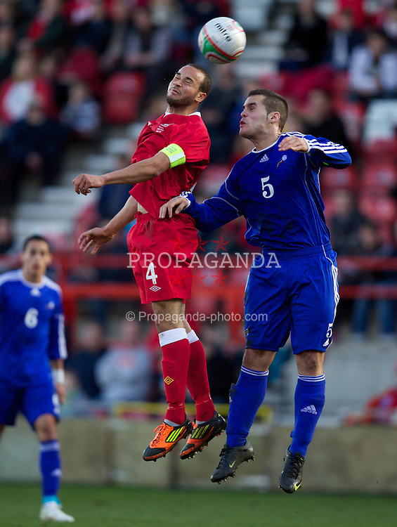 WREXHAM, WALES - Wednesday, February 29, 2012: Wales' captain Ashley Richards (Swansea City) and Andorra's captain Alex Roca (FC Andorra) during the UEFA Under-21 Championship Qualifying Group 3 match at the Racecourse Ground. (Pic by Vegard Grott/Propaganda)