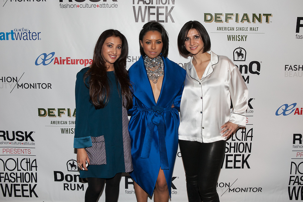 Fashion designer Shriya Bisht (l), actress Kat Graham (m), and fashion designer Danielle Salinas (r) after the designer's Maison de Papillon show at Nolcha Fashion Week New York Fall-Winter 2014. Nolcha Fashion Week New York is a leading award winning event, held during New York Fashion Week, for independent fashion designers to showcase their collections to a global audience of press, retailers, stylists and industry influencers. Over the past six years Nolcha Fashion Week: New York has established itself as a platform of discovery promoting innovative fashion designers through runway shows and exhibition. Nolcha Fashion Week: New York has built an acclaimed reputation as a hot incubator of new fashion design talent and is officially listed by New York City Economic Development Corporation; offering a range of cost effective options to increase designers recognition and develop their business. (Photo: www.JeffreyHolmes.com)