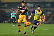 Bradford City midfielder Josh Cullen (14) plays a pass watched by Oxford United striker Chris Maguire (10) 2-0 during the EFL Trophy match between Oxford United and Bradford City at the Kassam Stadium, Oxford, England on 31 January 2017. Photo by Alan Franklin.