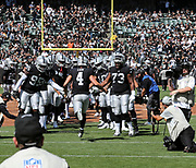Sep 30, 2018; Oakland, CA, USA;  Oakland quarterback Derek Carr (4) taking the field for a game between the Oakland Raiders and the Cleveland Browns. The Raiders defeated the Browns 45-42 in overtime. Mandatory Credit: Spencer Allen-Image of Sport