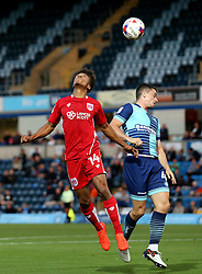 Bobby Reid of Bristol City heads the ball over Stephen McGinn of Wycombe Wanderers - Mandatory by-line: Robbie Stephenson/JMP - 09/08/2016 - FOOTBALL - Adams Park - High Wycombe, England - Wycombe Wanderers v Bristol City - EFL League Cup