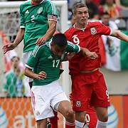 Francisco Rodriguez, Mexico, (left), wins a header from Steve Morrison, Wales, (right), and team mate Jesus Zavala, (below), during the Mexico V Wales international football friendly match at MetLife Stadium, East Rutherford, New Jersey, 23rd May 2012. Photo Tim Clayton