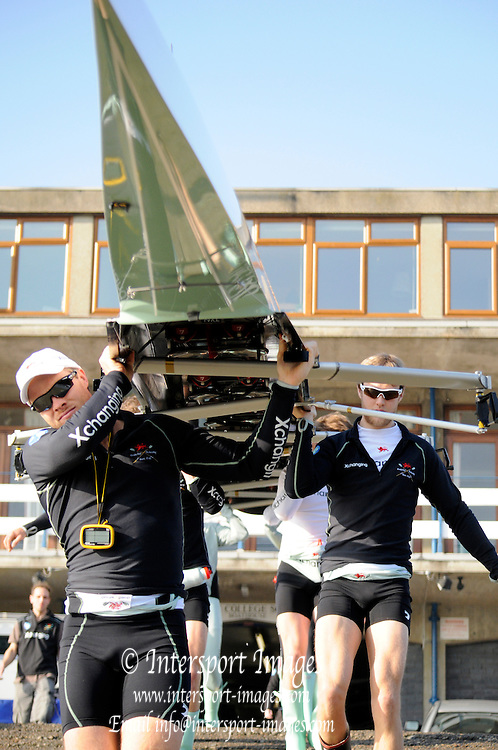 Putney. London. Tideway Week build up to the   2011 University Boat Race over parts of the Championship Course - Putney to Mortlake. Cambridge, CUBC, [Blue Boat] bring boat from the Boathouse. Wednesday 23/03/2011  [Mandatory Credit; Karon Phillips/Intersport-images]..Crew:.CUBC. Bow Mike THORP, 2 Joel JENNINGS, 3 Dan- RIX STANDING, 4 Hardy CUBASCH, 5 George NASH, 6 Geoff ROTH, 7 Derek RASMUSSEN, Stroke David NELSON and Cox Liz BOX 2011 Tideway Week