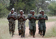 Nkwe wildlife security services offer a paramilitary - style rhino protection service that operates in the several private game reserves in the Limpopo area of South Africa..Nkwe's recruits undergoing a basic two week training program involving military drilling to become field rangers. From this stage the field rangers may be selected to for an advance course that focuses on firearms and tactical training. Once this is completed they will be goven rank and go on armed patrol to protect the rhinos...Nkwe Wildlife Security Services based in the Lapalala Wilderness Area, Limpopo, South Africa...© Zute Lightfoot