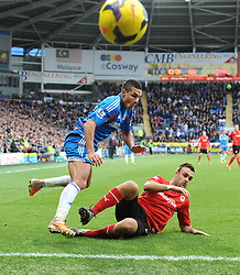 Cardiff City's Juan Cala blocks Hull City's Jake Livermore's cross   - Photo mandatory by-line: Joe Meredith/JMP - Tel: Mobile: 07966 386802 22/02/2014 - SPORT - FOOTBALL - Cardiff - Cardiff City Stadium - Cardiff City v Hull City - Barclays Premier League