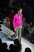 A model presents a creation by Hugo Boss during the Fall-Winter 2004 Collection show in New Delhi, India, Wednesday, Oct. 27, 2004. (AP Photo/Sebastian John)