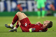 Liverpool midfielder Jordan Henderson (14) lies injured after a heafty challenge during the Champions League Quarter-Final Leg 1 of 2 match between Liverpool and FC Porto at Anfield, Liverpool, England on 9 April 2019.