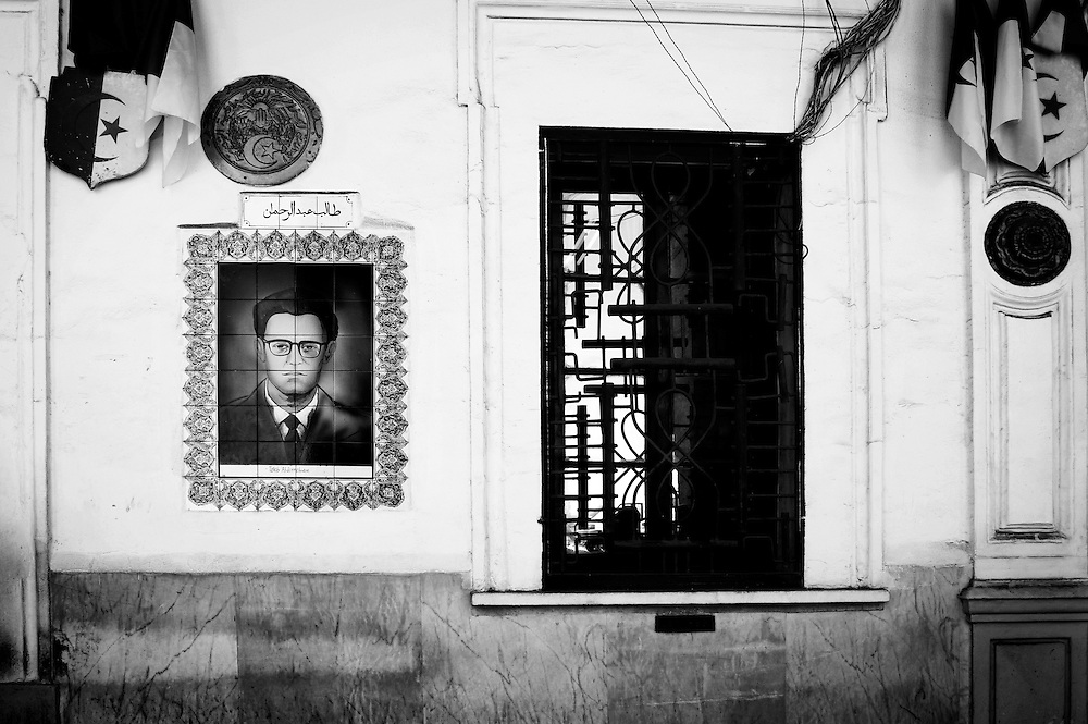"""Algiers May 2012. A portrait of Taleb Abderrahmane painted on the wall of the police station in rue Angkor, Algiers. He was a chemistry student when Taleb joined the FLN in 1955.  Arrested in June 1957 on southern Blida Taleb was accused to be the chemist of the """"network bombs"""" of Saadi Yacef during the Battle of Algiers, he was guillotined the 24th April1958."""