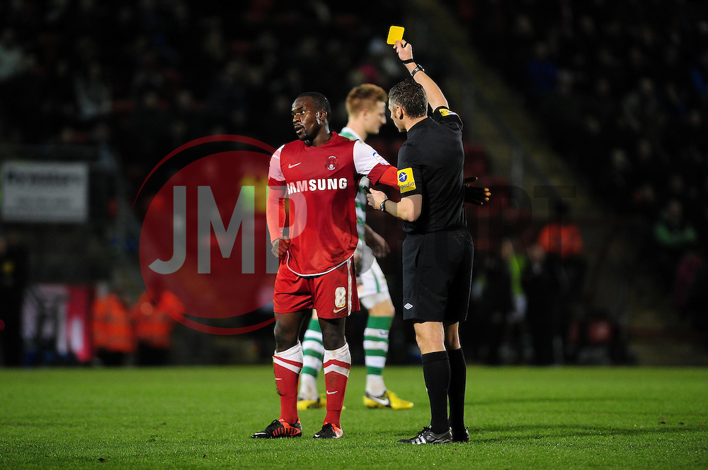 Leyton Orient's Anthony Griffith receives his first yellow card after fouling Yeovil Town Gavin Williams - Photo mandatory by-line: Dougie Allward/JMP - Tel: Mobile: 07966 386802 09/01/2013 - SPORT - FOOTBALL - Matchroom Stadium - London -  Leyton Orient v Yeovil Town - Johnstone's Paint Trophy Southern area semi-final.