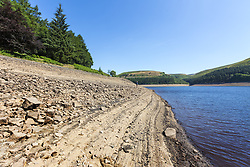 July 5, 2018 - Upper Derwent Valley, Derbyshire, UK - Upper Derwent Valley UK. Scenes this morning at Howden Reservoir in Derbyshire show the extent the water level has dropped during the UK heatwave leaving a sun scorched shoreline. (Credit Image: © Andrew Mccaren/London News Pictures via ZUMA Wire)