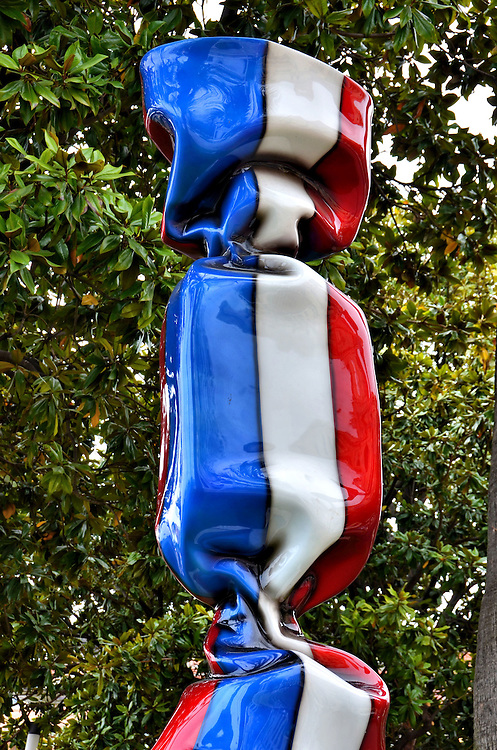 Bonbon Drapeau France Sculpture in Cannes, France <br /> Apparently, local artist Laurence Jenkell has a real sweet tooth because this 6.5 foot sculpture of candy wrapped in a French flag called &ldquo;Bonbon Drapeau France,&rdquo; is just one example of his twisted plexiglas specialties.  A highlight of his artistic career was in 2011 when he created 55 of these candy wrapper sculptures representing the flags of the nations attending the G20 conference, an annual summit of the world&rsquo;s finance ministers and central bankers.