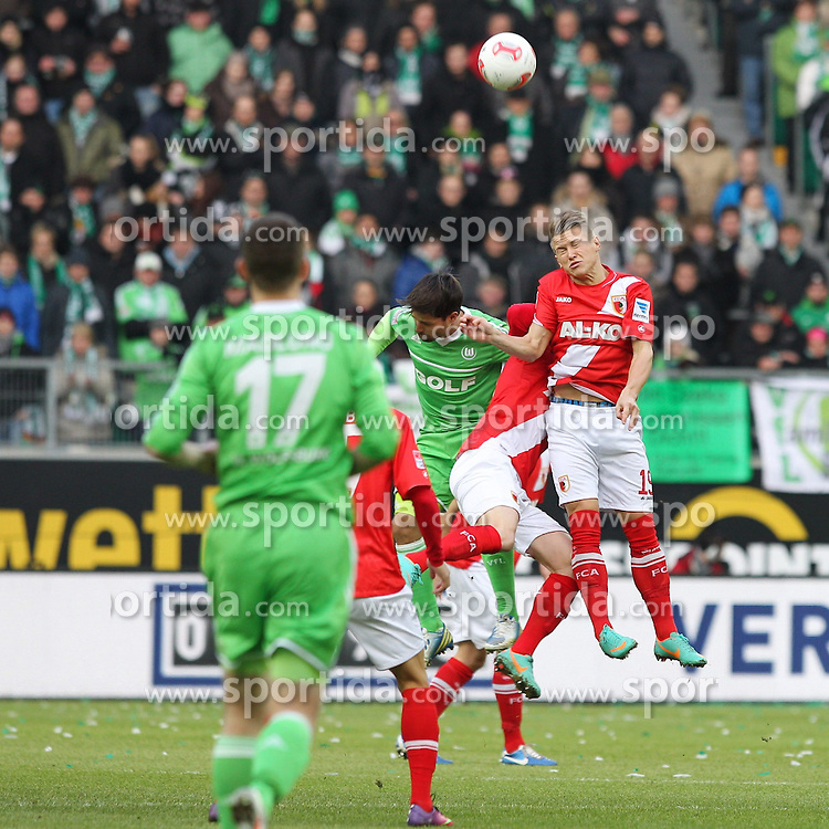 02.02.2013, Volkswagen Arena, Wolfsburg, GER, 1. FBL, VfL Wolfsburg vs FC Augsburg, 20. Runde, im Bild Kopfballduell zwischen links DIEGO #10 (VfL Wolfsburg) und Matthias OSTRZOLEK #19 (FC Augsburg) // during the German Bundesliga 20th round match between VfL Wolfsburg and FC Augsburg at the Volkswagen Arena, Wolfsburg, Germany on 2013/02/02. EXPA Pictures © 2013, PhotoCredit: EXPA/ Eibner/ Kolbert..***** ATTENTION - OUT OF GER *****