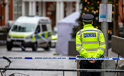 © Licensed to London News Pictures. 06/12/2019. London, UK. A policeman stands at the entrance to Hans Crescent next to Harrods after the body of what is believed to be a man in his 20s has been found with stab wounds outside Harrods Department Store in knightsbridge around 1am this morning. Photo credit: Alex Lentati/LNP