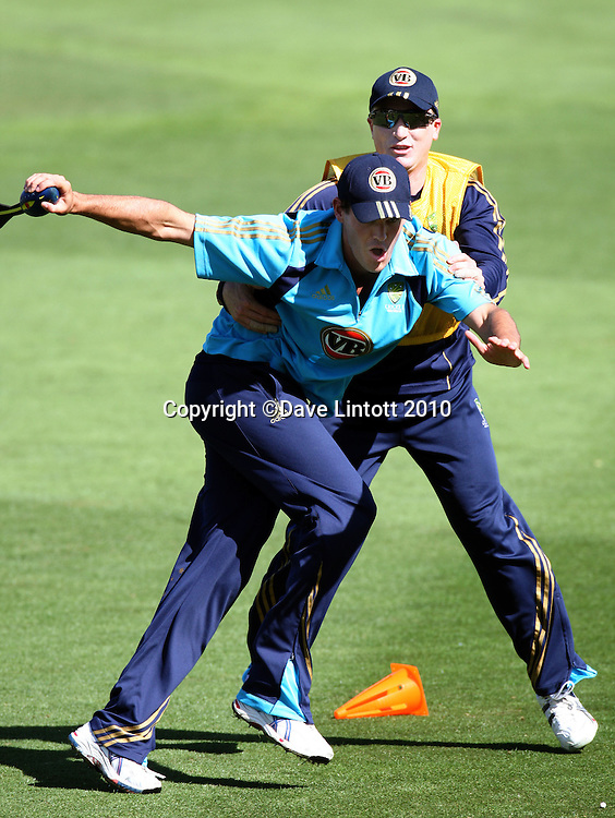 Brad Haddin wraps up Clint McKay.<br /> Australian cricket training at Allied Prime Basin Reserve, Wellington. Tuesday, 16 March 2010. Photo: Dave Lintott/PHOTOSPORT