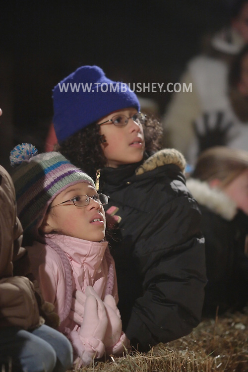 Pine Bush, NY -Children watch a performance during the Pine Bush Festival of Lights on Main Street on the evening of Dec. 1, 2007.