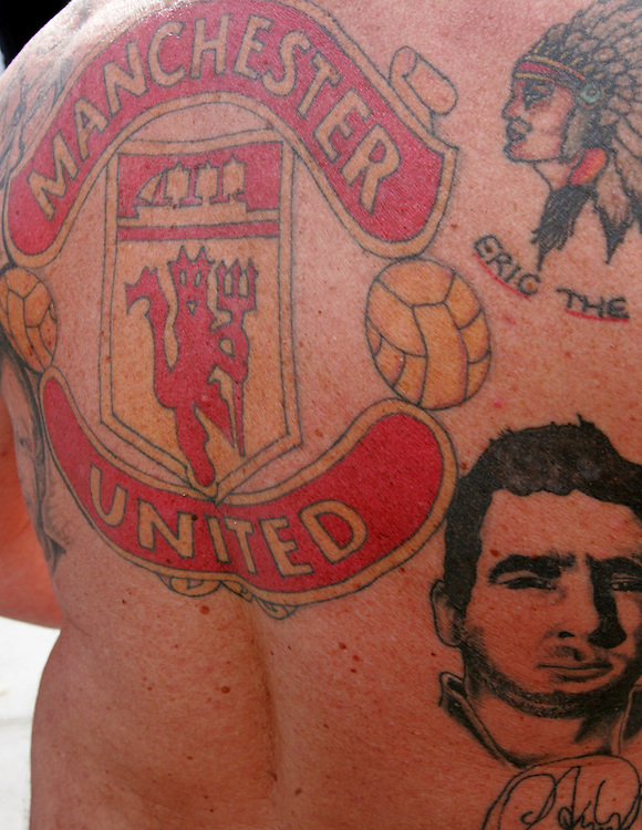 A Manchester United fan shows off his tattoo's. FA Cup Final, Wembley Stadium, 20th May 2007.
